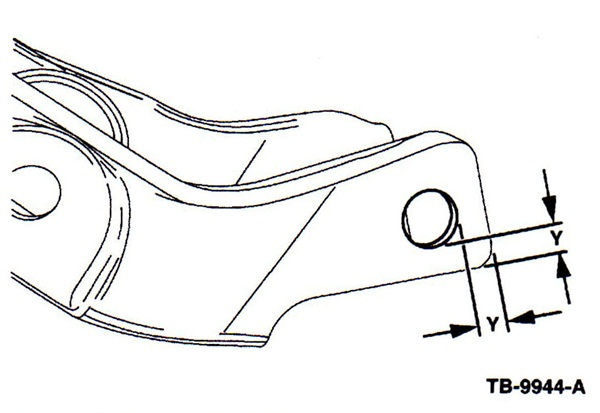 If the hole edges are less than 13/64-inch from the outer and bottom edge of the arm, the arm must be replaced.