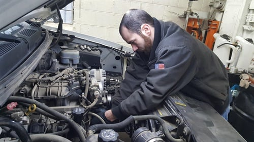 Technician Blake Smith from Mad Hatter Auto Service in Cedar Falls, Iowa, works on a customer's vehicle. Please share your tips with your fellow technicians!