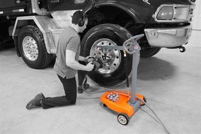 In addition to working at vehicle lift height, supporting the tool weight at low working height eliminates back and knee strain. (Courtesy of Martins Industries)