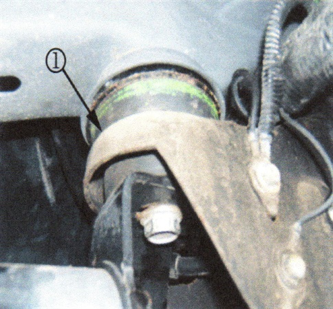 This photo shows the insulator (1) location after the body mount is reassembled.