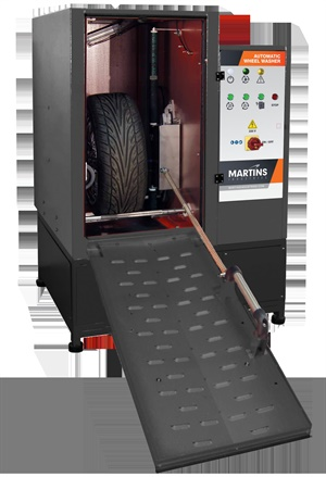 The easy and efficient way to clean customer wheels is Martins' automatic wheel washer. (Courtesy of Martins Industries)