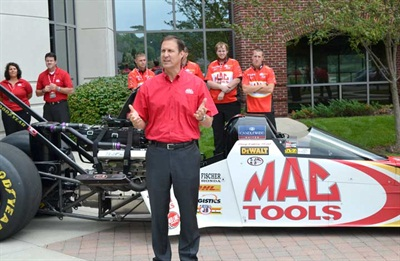 Mac Tools President Brett Shaw, next to the Doug Kalitta Mac Tools Top Fuel Dragster, said the company is committed to providing products that are made in the U.S.