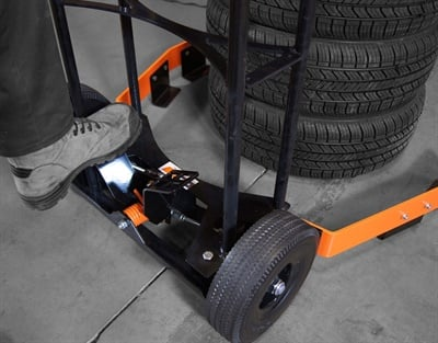 Improvements to the Tire Rider Tuff tire cart include a steel spring mechanism, instead of a gas cylinder, for opening and closing the clamps to pick up the tires.