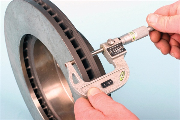 Measure rotor disc thickness at least 10 mm or so from the outer edge,  preferably about 1 inch inboard. Using a standard flat-anvil micrometer  is useful, but care must be taken to obtain an accurate reading.