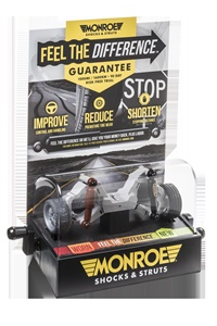 """The new Monroe """"Feel the Difference"""" shock simulator invites consumers to cycle a miniature vehicle's suspension through a variety of driving conditions."""