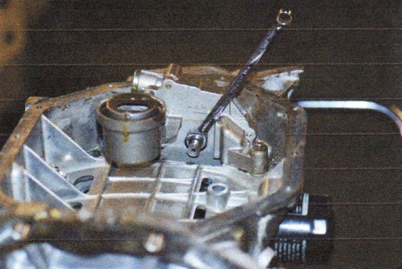 Note the location of the width-across-flat area of the oil pump shaft (wrench engaged).