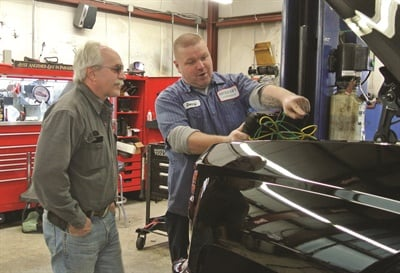 Certified tech Donny Laws discusses repairs to a customer's vehicle. Neubauer's techs make a point of establishing close one-on-one relationships with their customers.