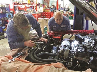 The shop places emphasis on technician training in order to keep pace with new vehicle technology. Here Bob Fernholz and R.J. Piosall diagnose a drivability issue.