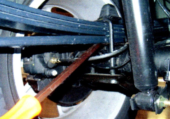 Use a pry bar to separate the spring pack from the seat.