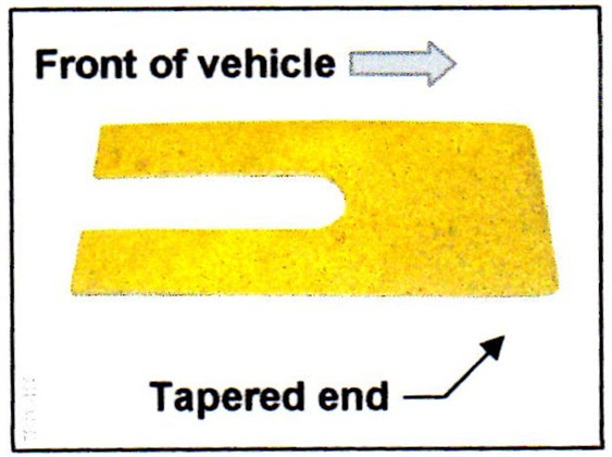 Insert one shim at each spring seat. Install the shim from the front. The tapered end of the shim must face the front of the vehicle.