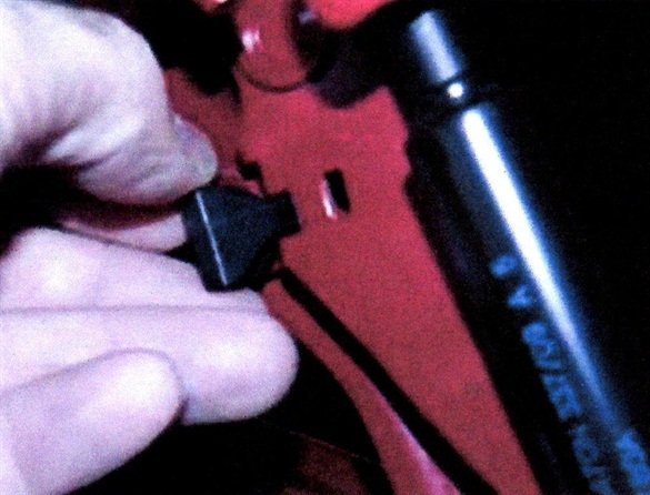 Install the stopper clips and hold in place until the adhesive sets.