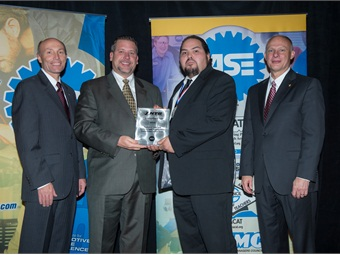 (L to R): Tim Zilke, ASE president; Ron Gooch, DVP TBC Retail Group; Chris Fryar (Tech of the Year) and Mike Phillips, ASE board chairman.