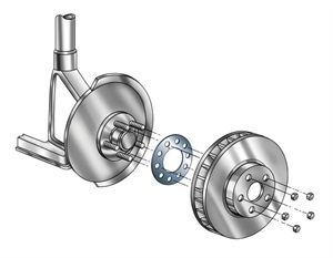 The brake alignment shim is placed between the hub and rotor, oriented to correct lateral runout.