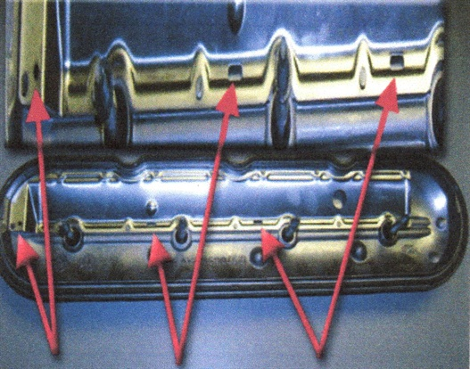Inspect the PCV baffle drain holes. If plugged with hardened oil,  replace the valve cover and advise the customer to follow their oil  change schedule.
