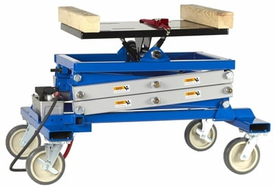 The new OTC powertrain lift is an air/hydraulic operation featuring a scissor-type design.