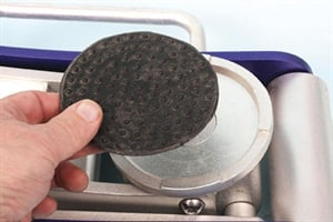 The 4-inch diameter stippled rubber pad is removable when/if not needed.
