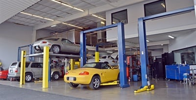 Formerly an airplane hangar, the service bay area is roomy and features a high ceiling.