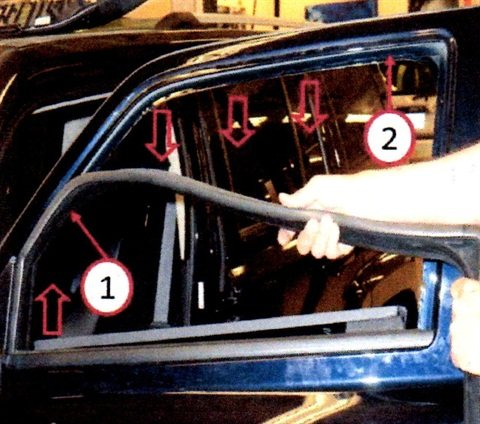 Remove the rest of the weatherstrip (1) by pulling down and around the top perimeter of the door channel (2) and pull the end of the weatherstrip up out of the door near the door mirror.