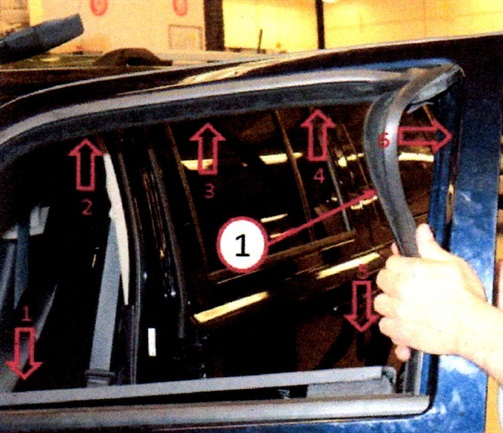 Make sure the glass run is seated below the outer and inner weatherstrip beltline (directional arrows) before installing the door module and glass.