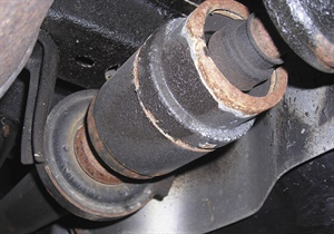 Universal joints and constant velocity (CV) joints on the rear propeller shaft are a common source of vibration. Care has to be taken to properly support the shaft when removing it to prevent bending and joint damage by letting it hang on the last joint during disassembly. Shown here is a hanger bearing and a CV style joint.