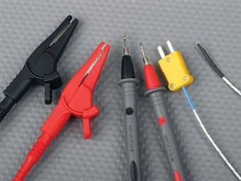 Typical probes included with a multimeter kit may include alligator clips (useful for checking insulation) and pin-prick probes, suitable for hand-held contact as well as penetrating insulation or back-probing a connector, as well as a thermocouple, useful for reading surface temperatures for a variety of components.