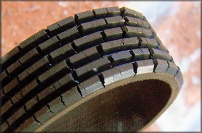 This shows a used neoprene belt showing the familiar cracks that result from aging.