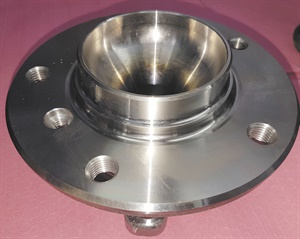 Note the wheel mounting stud holes, the  rotor retainer and the spigot or pilot that allows wheel and rotor centering.