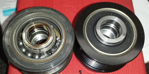 For comparison, here is the new OAD pulley beside the old, worn-out one. The worn-out pulley created an obvious noise and was actually wearing into the front case of the alternator.