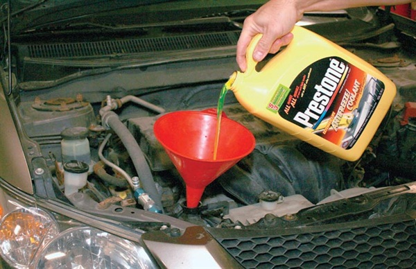 """This looks like the traditional green coolant, but look closely and it says """"all makes, all models, add to any color antifreeze."""""""