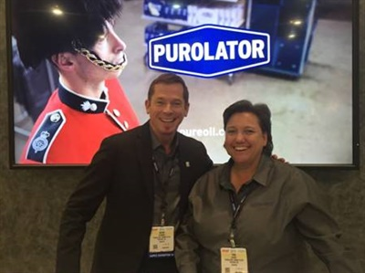Kevin O'Dowd, global director of product and brand marketing for the automotive aftermarket, and Tina Davis, senior marketing manager of brand and communications at Mann+Hummel Purolator Filters, celebrate winning the award at AAPEX.
