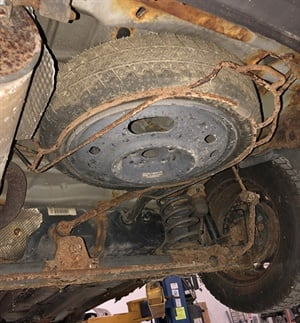 Ignored spare tire carriers can become rusted and difficult to lower. Apply penetrant lube to the threaded adjuster and run the threads up/down to make sure it functions.