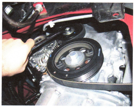 Remove the serpentine belt from the compressor pulley.