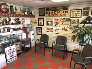 The pleasing-to-the-eye customer waiting room is adorned with a tasteful array of vintage automotive memorabilia.