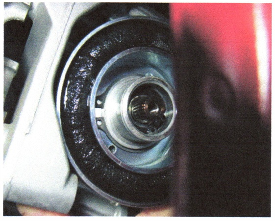 Use a straight circlip tool to remove the clip from the clutch magnet.