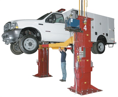 If the shop plans to service heavy-duty trucks, consider the load rating capabilities, as your current lifts may not be able to handle the added weight. Shown here is an example of a twin-post lift rated at up to 30,000 lbs. Photo courtesy of Mohawk Lift.