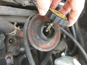 If power steering fluid is contaminated, the system should be flushed. If foamy, the system needs to be bled. If burnt-smelling, it may be time for a new pump, but a flush and refill is worth a try.