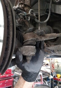 Outer tie rod ends are easily checked for vertical play and excess radial movement.