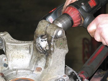 If the lower strut mount features a slip-in design and the collar reveals corrosion or burrs, in some cases it may be necessary to remove the steering knuckle in order to dress the collar, using a pneumatic or electric power tool and abrasive bit. Photo by author.
