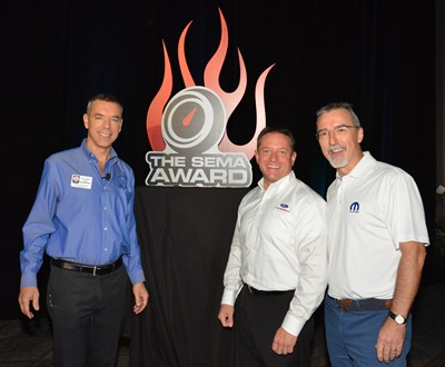 The 2015 SEMA Award for Hottest Car for the Ford Mustang, Hottest Truck for the Ford F-Series and Hottest Sport Compact for the Ford Focus was presented by SEMA President and CEO Chris Kersting (left) to Global Director Ford Performance Dave Pericak (center). The SEMA Award for Hottest 4x4-SUV went to Jeep for the Jeep Wrangler, and was presented to Pietro Gorlier (right), head of Mopar.
