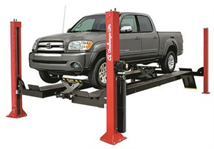 Many four-post lifts can be outfitted with optional cross-members and hydraulic jacks to accommodate suspension unloading. Photo courtesy Challenger Lifts