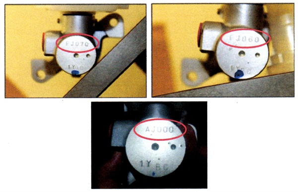 Brake master cylinder part numbers are stamped into the front face of the cylinder housing.