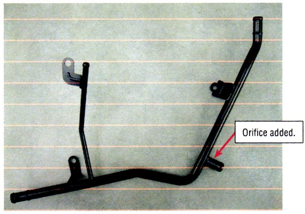 A revised heater hose pipe features an added orifice designed to regulate coolant flow past the coolant temperature sensor.