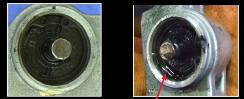 During slow compression, a very slight oil seepage is normal (left). A failed tension adjuster will pass a noticeable amount of oil past the rod seal (right).