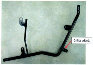 A revised Subaru heater hose pipe helps to regulate coolant flow past the temperature sensor.
