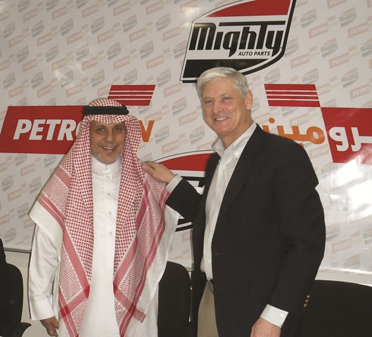 Samir Nawar, president and CEO of Petromin Corp., and Ken Voelker,  president and CEO of Mighty Distributing System of America, at the  signing.