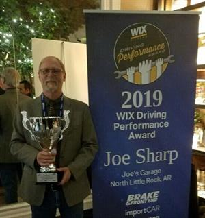 Joe Sharp, shop owner at Joe's Garage in North Little Rock, Ark., held his new trophy after winning the 2019 WIX Driving Performance Award.