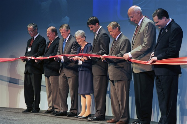 L to R: Kenosha Mayor Keith Bosman, retired Snap-on CEO Robert Cornog,  current Snap-on chairman and CEO Nick Pinchuk, Mary Johnson, Congressman  Paul Ryan, Greg Johnson, retired CEO Jack Michaels and Alderman Ray  Misner, cutting the ribbon at the Snap-on IdeaForge grand opening event.