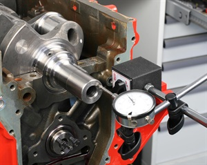 After installing a new thrust bearing, lightly knock the crankshaft fore and aft with a brass hammer before torqueing the main caps. This will aid in squaring-up the thrust bearing cap. Using a dial indicator, push the crankshaft rearward and zero the indicator gauge, then push the crankshaft forward to observe the amount of crankshaft endplay.