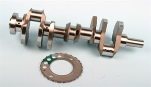A crankshaft-mounted reluctor wheel features a series of teeth that provide a crank position signal to the crankshaft position sensor.