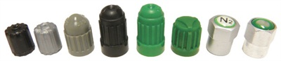 Shown here is an array of caps intended for TPMS applications. In this photo, notice that the two caps on the right look like metal. The second cap from the right is a chrome-plated plastic and the cap on the far right is a chrome-plated aluminum cap.